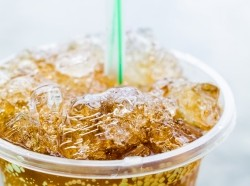 cola in plastic to-go cup