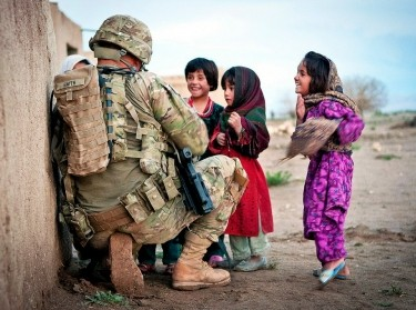 Afghan girls talking with a U.S. soldier