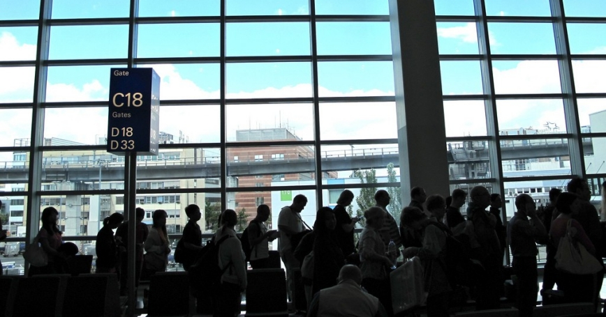 Airline passengers waiting to board