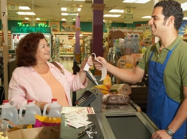 woman at grocery store checkout