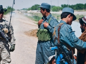a U.S. Army soldier and Afghan National Policemen