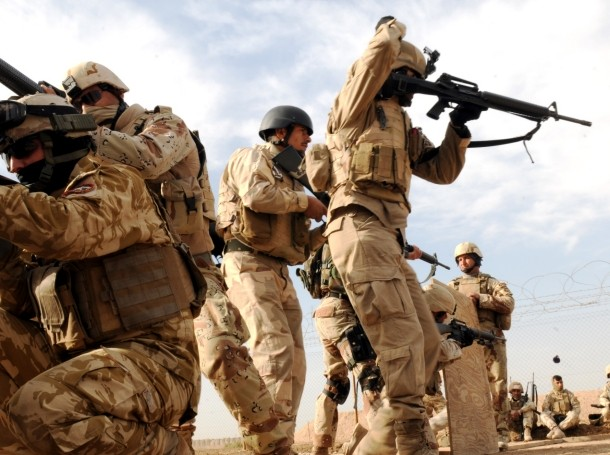 Iraqi Army soldiers practice prior to an urban operations live-fire exercise at Camp Taji in December 2010