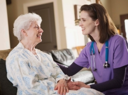 nurse with old patient