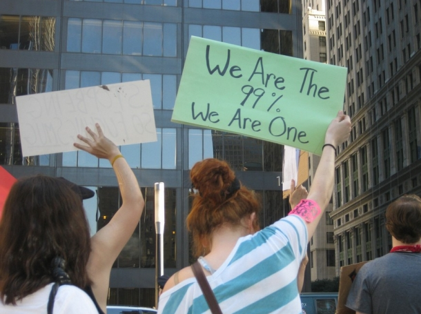 """""""We are the 99%. We are the one"""" sign held at Occupy Wall Street on 10/09/2011"""