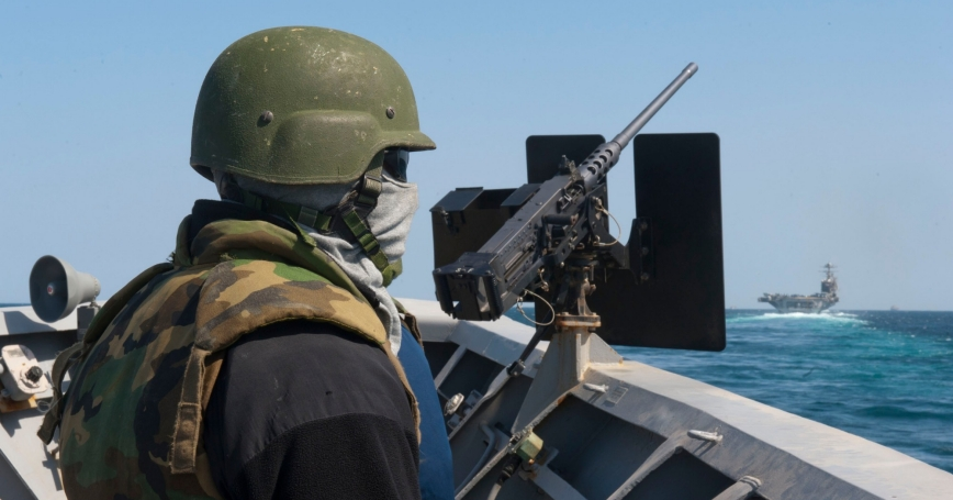 A sailor mans a small craft attack team post in the Strait of Hormuz