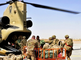 U.S. Army Soldiers prepare to board a CH-47 Chinook helicopter on Camp Marmal in Afghanistan