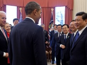 Pres. Barack Obama and VP Joe Biden talk with Xi Jinping of the People's Republic of China on Feb. 14, 2012