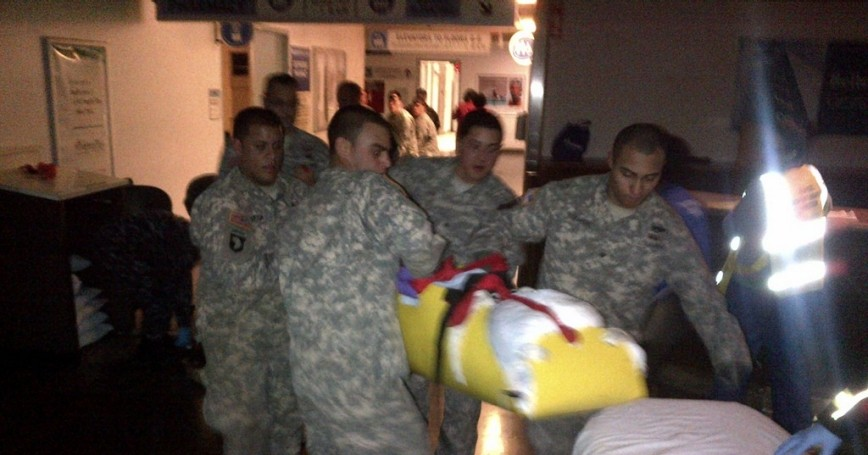 New York Army National Guard soldiers evacuate patients from Bellevue Hospital on Oct. 31, 2012 due to Hurricane Sandy