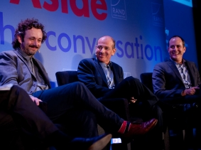 Michael Sheen, Howard Gordon, and David Nevins at RAND's Politics Aside event