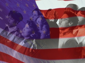 an American flag superimposed over a group of people