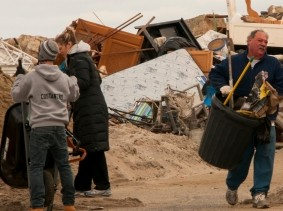 Volunteers assist with the clean up efforts in Sea Bright, NJ, after Hurricane Sandy