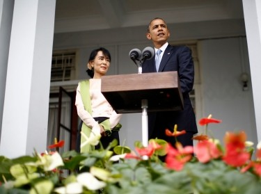 U.S. President Barack Obama speaks alongside Nobel Peace Prize laureate and long-time opposition leader Aung San Suu Kyi at her residence in Yangon, Myanmar, November 19, 2012