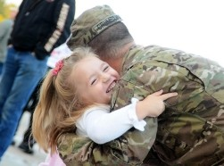 A Soldier from the Michigan National Guard, is welcomed home by his daughter after a year long tour in Afghanistan on Sept. 28, 2012.