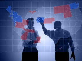 men looking at a United States political map