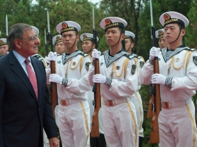 U.S. Secretary of Defense Leon E. Panetta walks through an honor cordon at the Chinese North Sea Fleet headquarters in Qingdao, China in September 2012