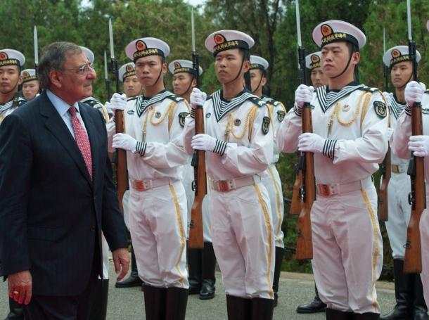 U.S. Secretary of Defense Leon E. Panetta walks through an honor cordon at the Chinese North Sea Fleet headquarters in Qingdao, China