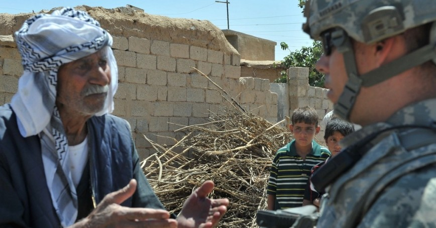 Farmer in Kirkuk, Iraq voices his concerns to a U.S. Army soldier