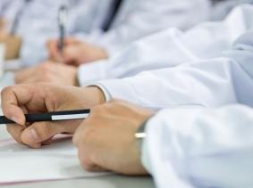 Doctors in a board room