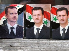 Portraits of Bashar al-Assad lined up in Damascus, Syria