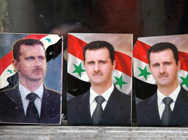 Three portraits of Bashar al-Assad are lined up in Damascus, Syria