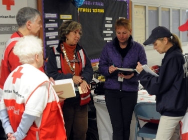 Red Cross Shelter volunteers discuss coordination of services for survivors of Hurricane Sandy
