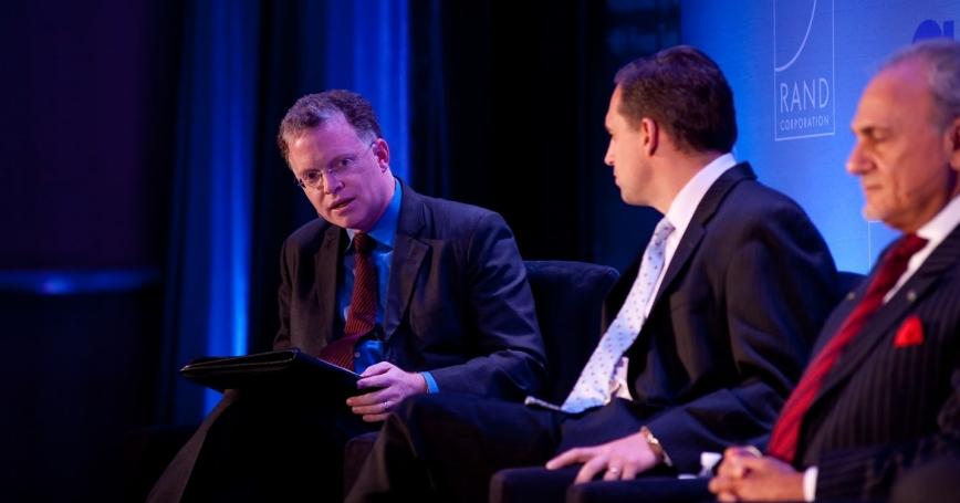 David Rohde, Seth Jones, and Prince Turki Al Faisal at RAND's Politics Aside event