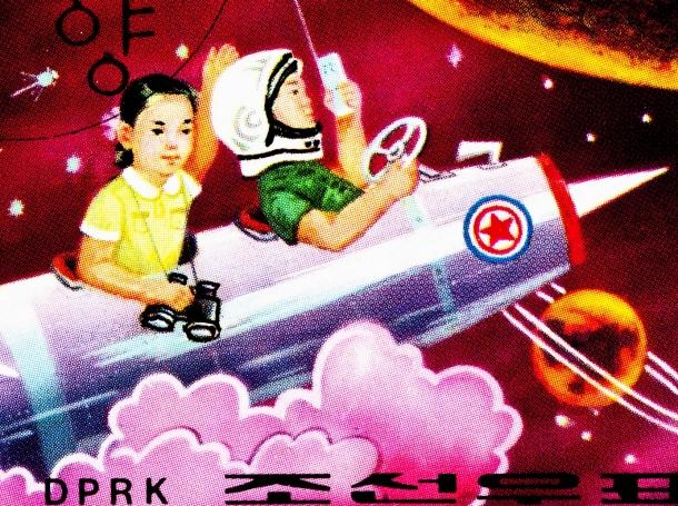 North Korean stamp depicting children on a rocket