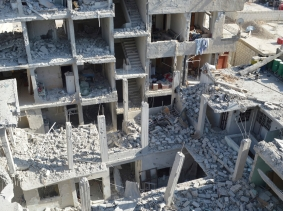 View of buildings damaged by what activists said were missiles fired by a Syrian Air Force fighter jet loyal to President Bashar al-Assad at Jessreen area in Ghouta east of Damascus, December 2, 2012