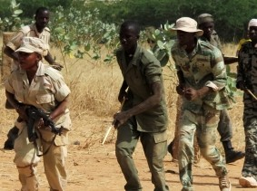 Malian pro-government militia members take part in a training session at their base in Sevare, Mali, November 12, 2012