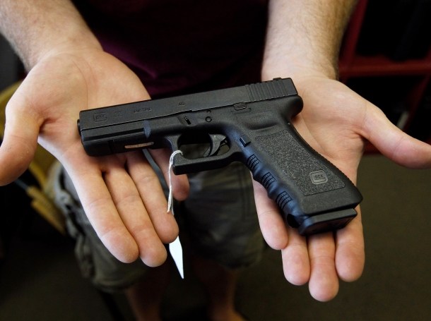 A Glock 22 pistol is displayed at the Rocky Mountain Guns and Ammo store in Parker, Colorado, July 24, 2012