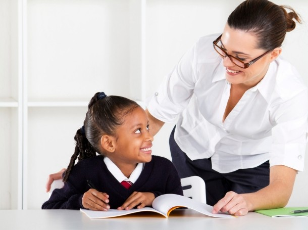teacher with elementary school student