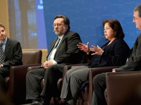 Lois Davis speaking at a RAND Policy Forum on Calfornia's prisoner dilemma on January 24, 2012, with  Greg Ridgeway, J. Clark Kelso, and R. Steven Tharratt