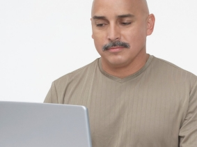 a male veteran using a laptop