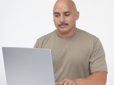 Middle aged man using laptop