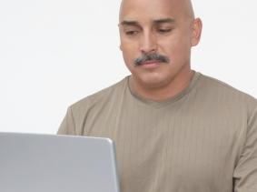 a male veteran using a laptop