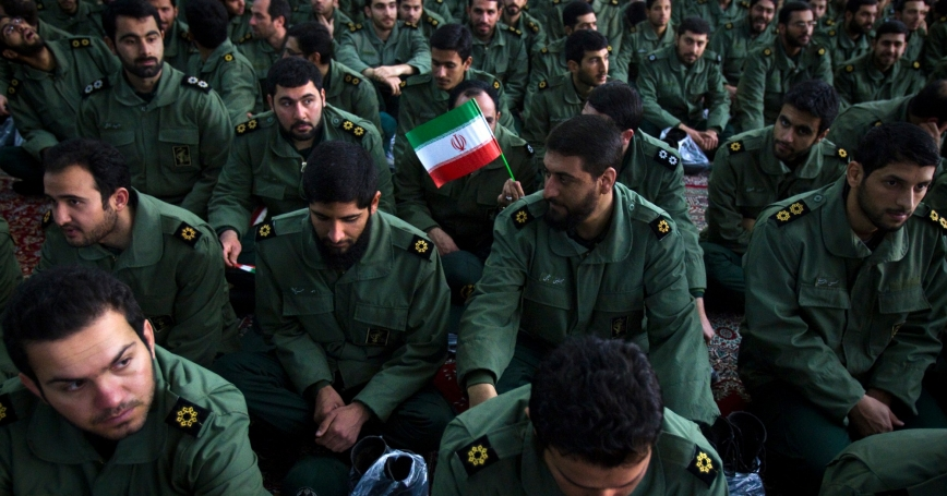 Members of the revolutionary guard attend the anniversary ceremony of Iran's Islamic Revolution at the Khomeini shrine in the Behesht Zahra cemetery, south of Tehran, February 1, 2012