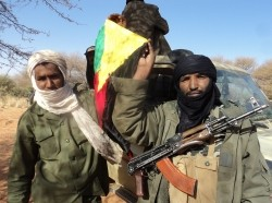 Touareg rebels in Mali hoist a flag