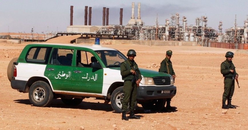 Algerian soldiers stand near the Tiguentourine Gas Plant in In Amenas, 994 miles southeast of Algiers, January 31, 2013