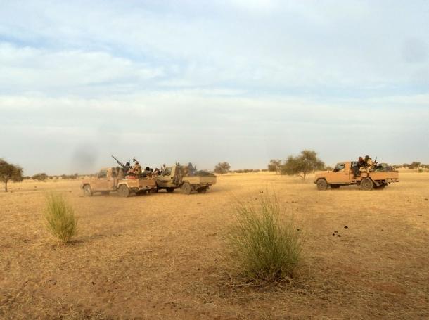 Armed Islamist fighters race near the Mauritania-Mali border