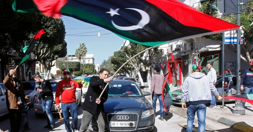 A man waves a Libyan flag during celebrations commemorating the second anniversary of the February 17 revolution in Tripoli February 17, 2013