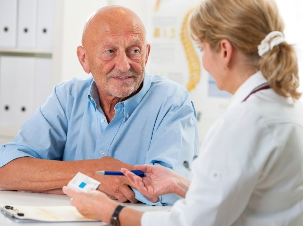 man discussing treatment with a doctor