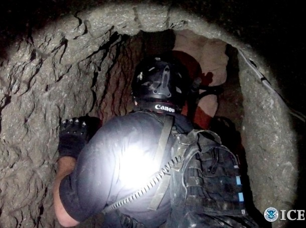 A Homeland Security agent enters a tunnel used to smuggle drugs between the U.S. and Mexico