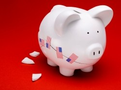 cracked piggy bank with U.S. flag stickers