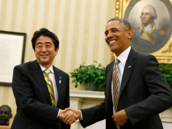 U.S. President Barack Obama shakes hands with Japanese Prime Minister Shinzo Abe in the Oval Office of the White House in Washington, February 22, 2013
