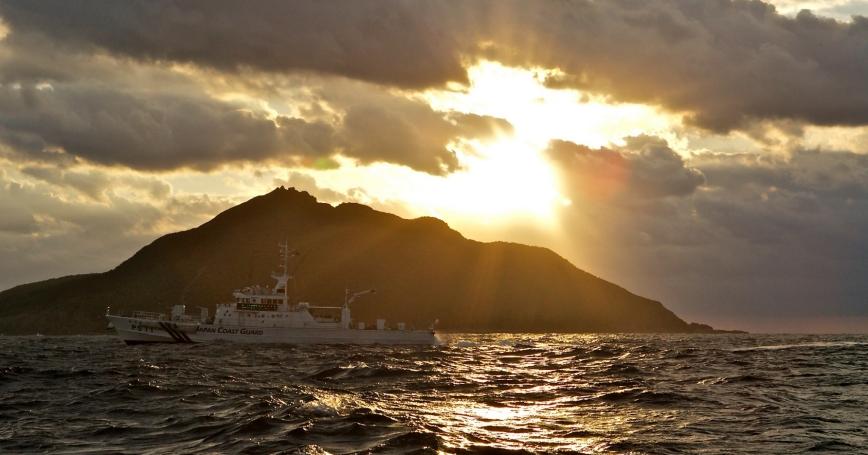 A Japanese Coast Guard patrol vessel passes by Uotsuri, the largest island in the Senkaku/Diaoyu chain.