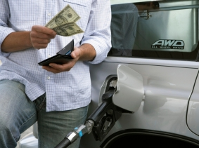Man filling gas tank