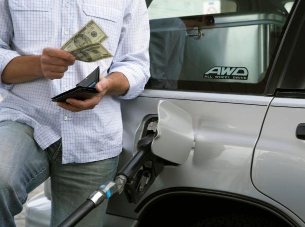 man filling car gas tank