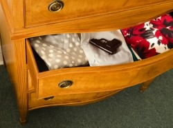 gun in dresser drawer