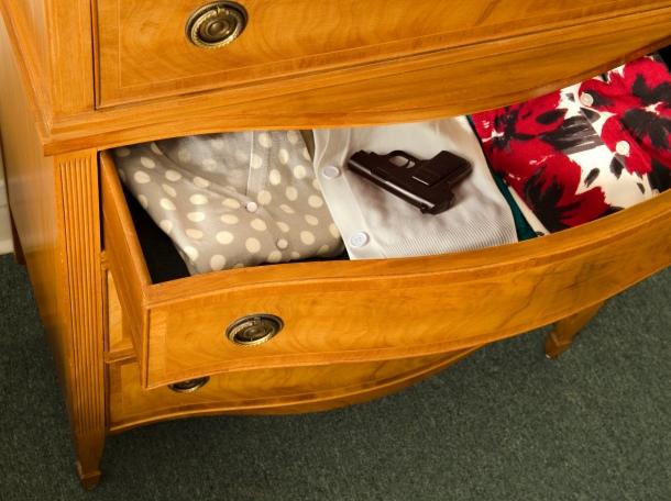 gun in dresser drawer
