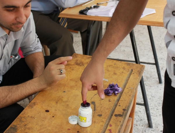A man inks his finger after voting in Ciaro, Egypt.